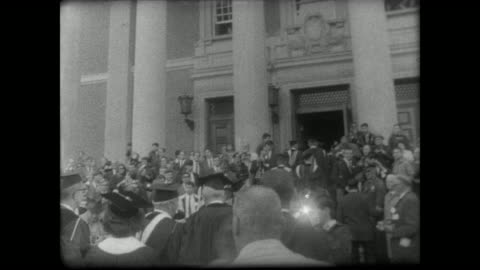 lady bird johnson in graduation robe walks along grounds of williams college with faculty, crowd and press / college president john sawyer escorts... - 1967 stock videos & royalty-free footage