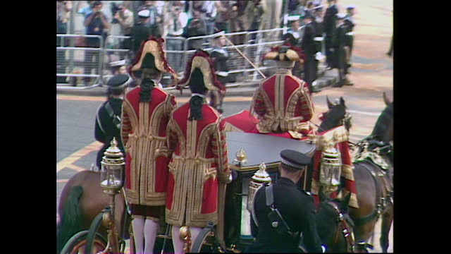 lady diana can be seen through the window of the glass coach as it passes trafalgar square on the procession to st paul's for the wedding of prince... - 1981 stock videos & royalty-free footage