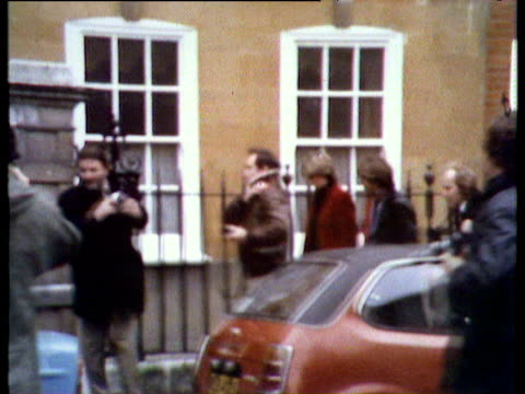 lady diana leaving her flat and walking down street surrounded by press and photographers prior to announcement of her engagement feb 81 - surrounding stock videos and b-roll footage