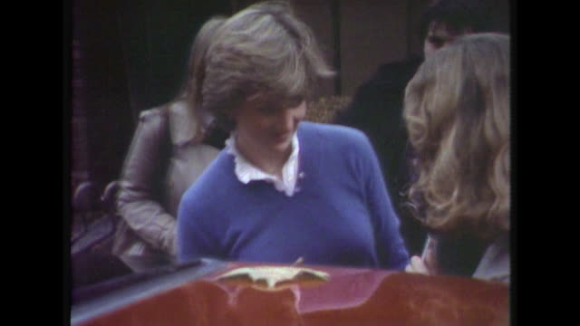 lady diana trying to get into a car while members of the press ask questions about her engagement to prince charles. - princess stock videos & royalty-free footage