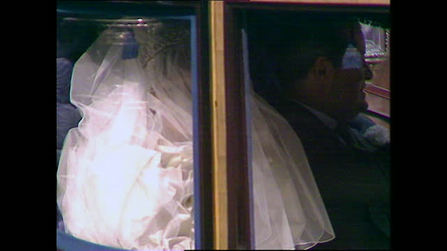 vidéos et rushes de lady diana waves at cheering crowds through the windows of the glass coach on her way to st paul's cathedral for the wedding of prince charles and... - 1981