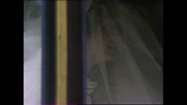 lady diana waves at cheering crowds through the windows of the glass coach as she makes her way to st paul's cathedral for the wedding of prince... - 1981 stock videos & royalty-free footage