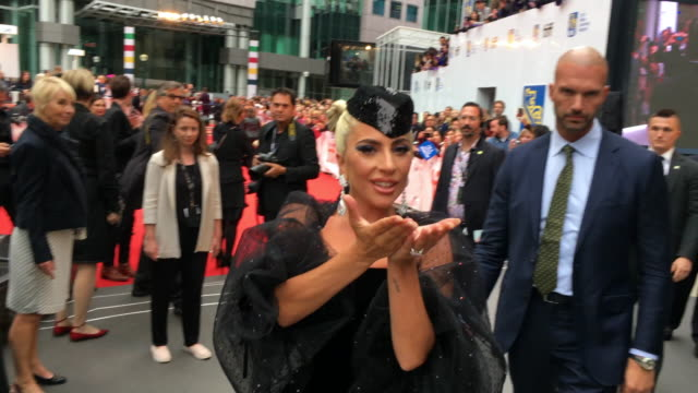 Lady Gaga actress in the movie A Star is Born greets fans during the red carpet event outside the Roy Thomson Hall in the downtown district of Toronto