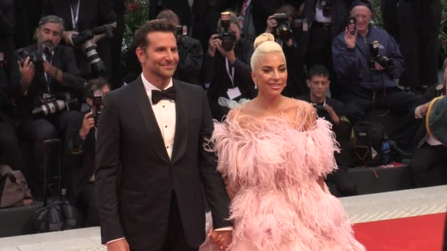 vídeos de stock, filmes e b-roll de lady gaga and bradley cooper on the red carpet for the premiere of a star is born at the venice film festival 2018 venice, italy on friday, august... - 2018