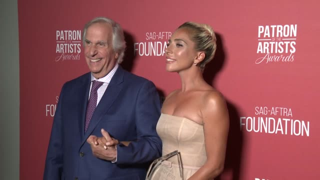 Lady Gaga and Henry Winkler backstage at the SAGAFTRA Foundation's 3rd Annual Patron Of The Artists Awards at Wallis Annenberg Center for the...
