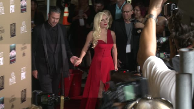 Lady Gaga and Taylor Kinney at FX's American Horror Story Hotel Los Angeles Premiere at Regal Cinemas LA Live on October 03 2015 in Los Angeles...