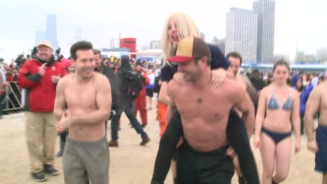 Lady Gaga And Taylor Kinney Take The Icy Polar Plunge Into Lake Michigan benefitting the Special Olympics at North Avenue Beach on March 01 2015 in...