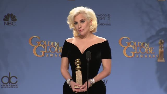 vídeos de stock e filmes b-roll de lady gaga at 73rd annual golden globe awards - press room at the beverly hilton hotel on january 10, 2016 in beverly hills, california. - vestido preto