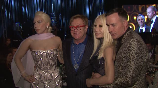 lady gaga, elton john, david furnish, and donatella versace at the elton john aids foundation presents 22nd annual academy awards viewing party... - versace designer label stock videos & royalty-free footage