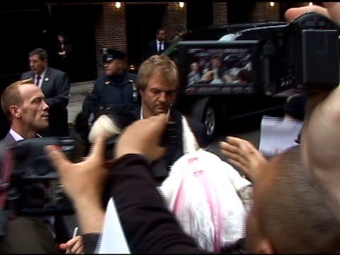 Lady Gaga makes her through her throng of fans as she departs the 'Late Show with David Letterman' in New York 05/23/11