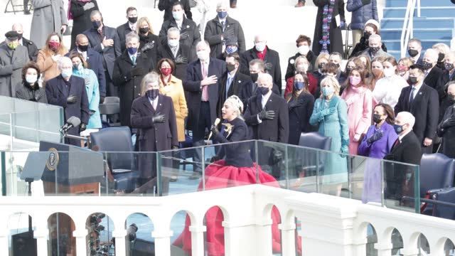 lady gaga sings the national anthem at the inauguration of u.s. president-elect joe biden on the west front of the u.s. capitol on january 20, 2021... - 就任式点の映像素材/bロール
