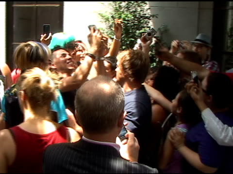Lady Gaga tries to get to her car as she departs the Grammercy Hotel in New York 06/07/11