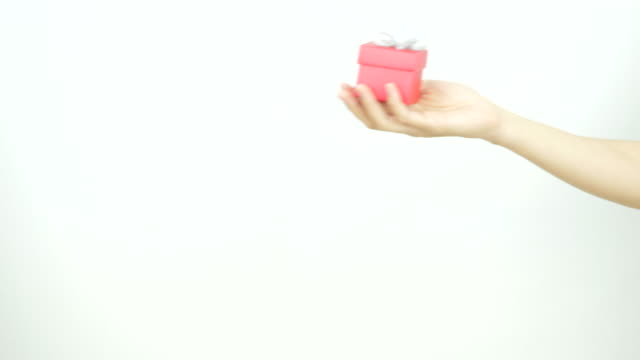 A lady gives a man a gift box on Valentine's Day.