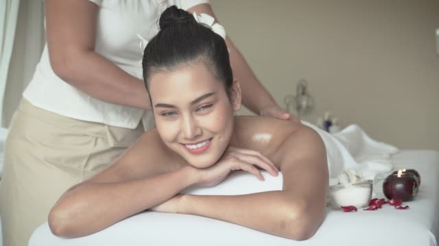 lady happy oil massage - massager stock videos and b-roll footage