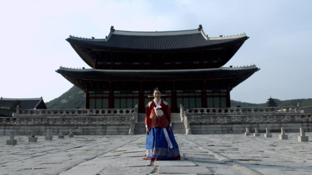 WS Lady in queen Dress bowing behind Gyeongbokgung Palace/ Seoul, South Korea