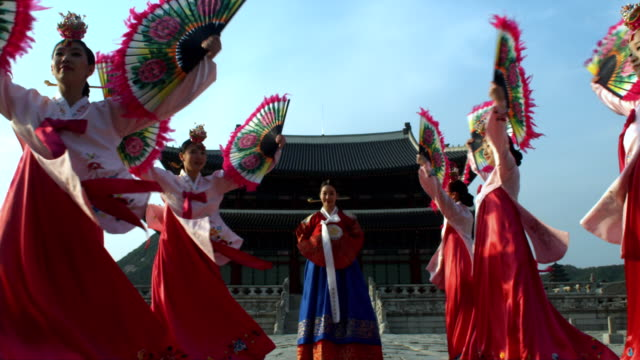 MS ZI Lady in queen Dress with fan dance group behind Gyeongbokgung palace / Seoul, South Korea