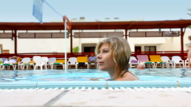 Lady in the swimming pool