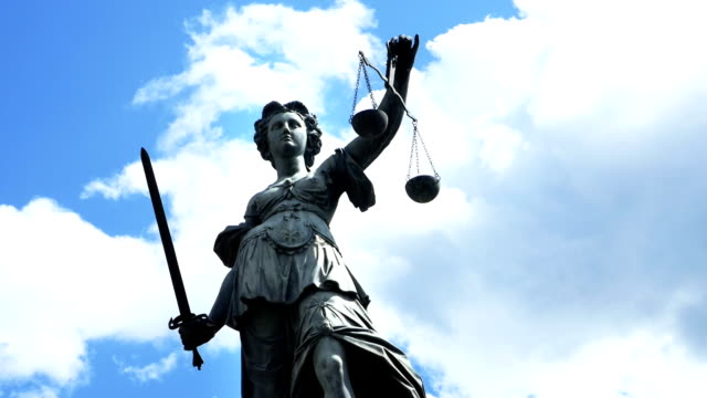 t/l lady justice against cloudy sky - equal arm balance stock videos and b-roll footage