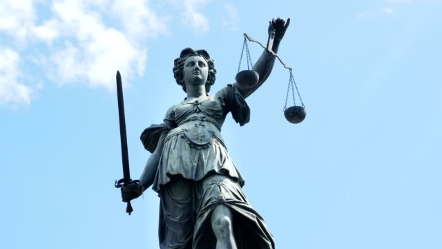 lady justice against cloudy sky (4k/uhd to hd) - equal arm balance stock videos and b-roll footage