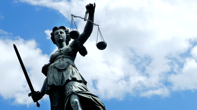 lady justice against cloudy sky (4k/uhd to hd) - weight scale stock videos & royalty-free footage
