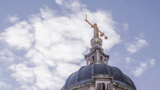 lady justice on the old bailey, london, england. - equal arm balance stock videos and b-roll footage