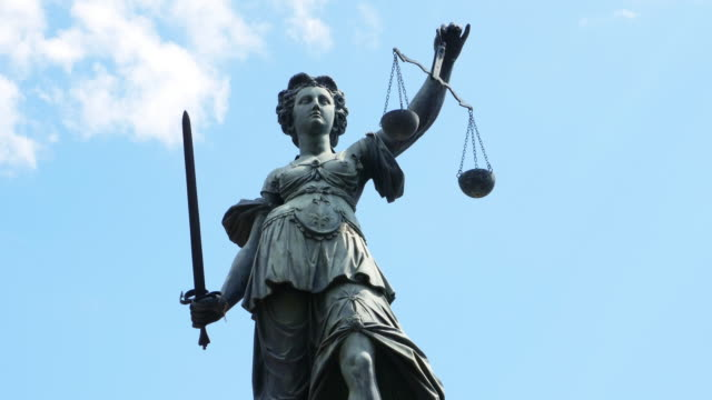 lady justice with scales and sword - scales stock videos & royalty-free footage