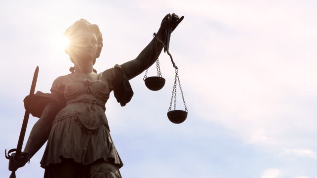 lady justice with sun - innocence stock videos & royalty-free footage