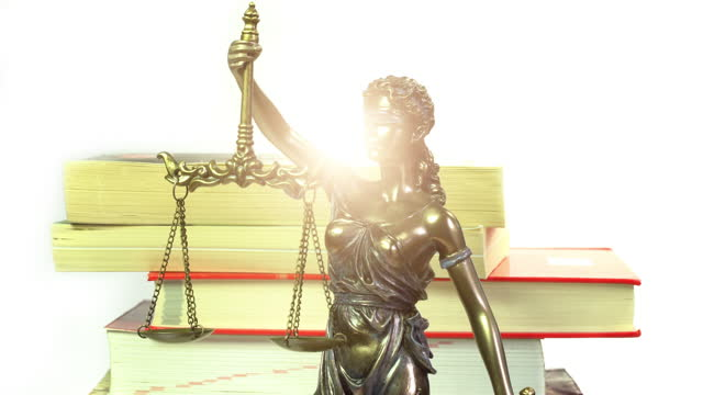 lady justitia with books - sentencing stock videos & royalty-free footage