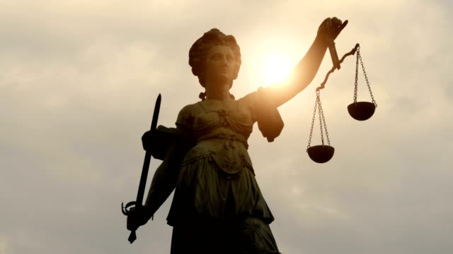 lady justitia with sun, time lapse - equal arm balance stock videos and b-roll footage