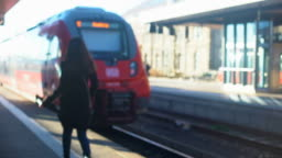 Lady late for train, running on platform, life in modern city, time-management