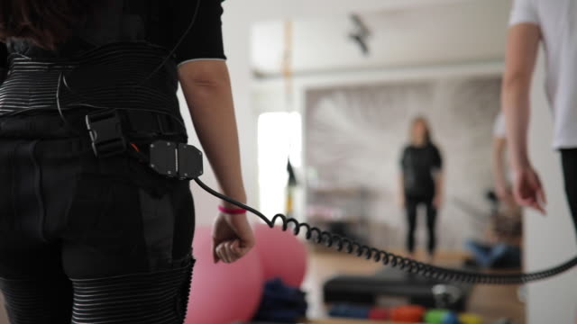 lady on ems training with personal trainer - plugging in stock videos & royalty-free footage