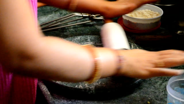 lady preparing chapati with rolling pin - rolling pin stock videos & royalty-free footage