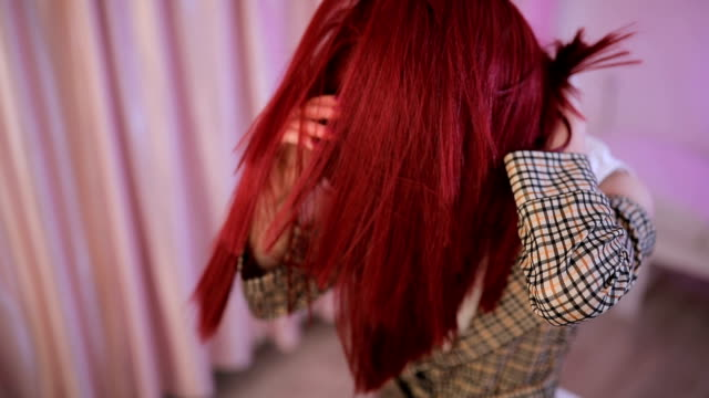 lady putting red hair wig on - preparation stock videos & royalty-free footage