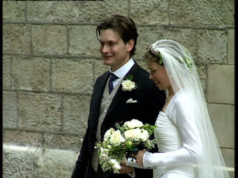 lady sarah armstrong jones and daniel chatto pose for photos before getting into car on their wedding day, london; 14th july 1994 - royalty stock videos & royalty-free footage