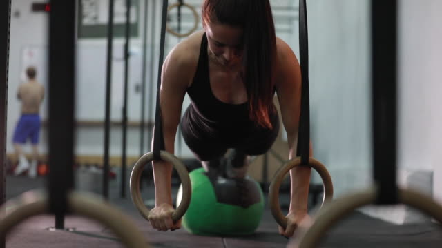 lady training hard in gym - push ups stock videos & royalty-free footage