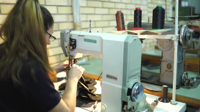 lady working on sewing machine - textile industry stock videos & royalty-free footage
