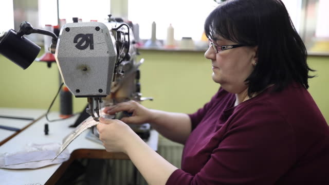 lady working on sewing machine - mature adult stock videos & royalty-free footage
