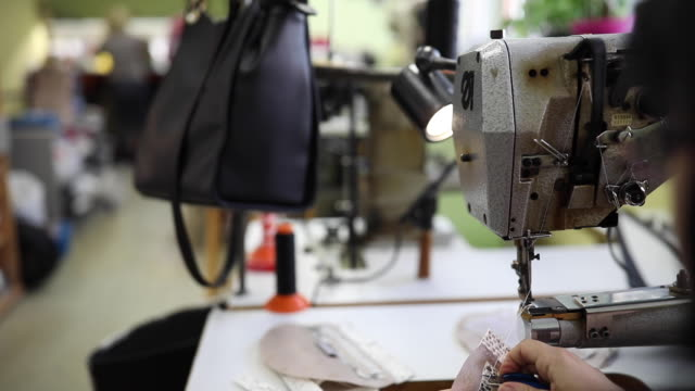 lady working on sewing machine - needle plant part stock videos & royalty-free footage