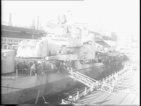 "laffey hit by japanese fire / view of battered deck gun / sign on gun turret that says ""killed eight enlisted men"" / sailor showing battered... - on air sign stock videos & royalty-free footage"