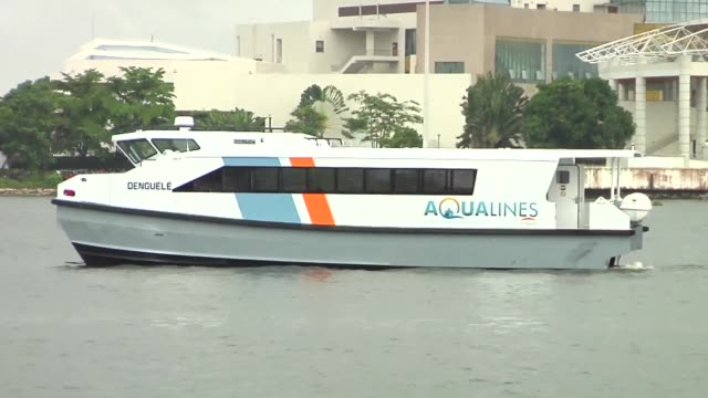 lagoon transportation is booming in abidjan as the private sector offers more comfortable boats with air conditioning and wifi - côte d'ivoire stock videos & royalty-free footage