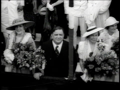laguardia standing with women who are wearing hats and holding flowers then speaking / new york city new york united states - fiorello la guardia stock videos & royalty-free footage