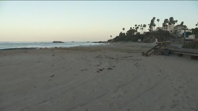 laguna beach, ca. u.s. - few people on the beach during covid-19 pandemic on tuesday, may 5, 2020. - laguna beach california stock videos & royalty-free footage