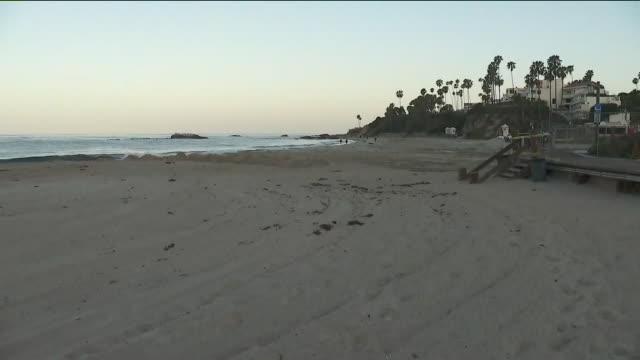 laguna beach, ca. u.s. - few people on the beach during covid-19 pandemic on tuesday, may 5, 2020. - laguna beach california stock-videos und b-roll-filmmaterial