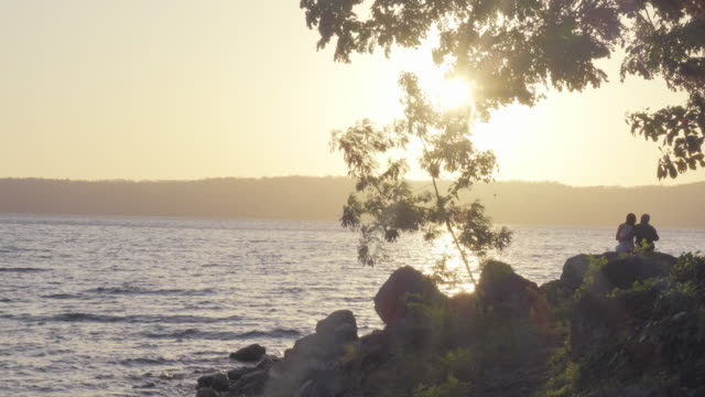 stockvideo's en b-roll-footage met laguna de apoyo lake at sunrise. nicaragua. a man and a woman together - managua