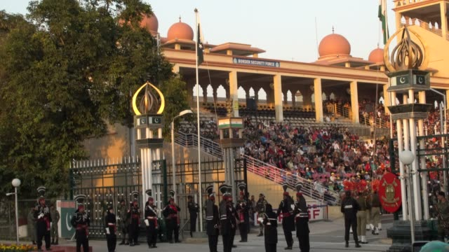 lahore, pakistan; december 2, 2019; wagah-attari border ceremony. the lowering of the flags ceremony at the attari-wagah border is a daily military... - practice drill stock videos & royalty-free footage