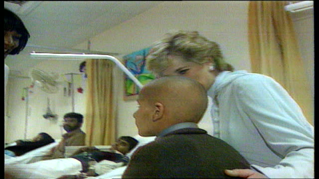 stockvideo's en b-roll-footage met lahore princess diana visiting cancer hospital with imran khan wife jemima princess diana holding young cancer victim on lap - lahore pakistan