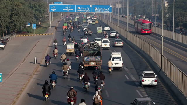 lahore rush hour traffic and metrobus - lahore pakistan stock videos and b-roll footage