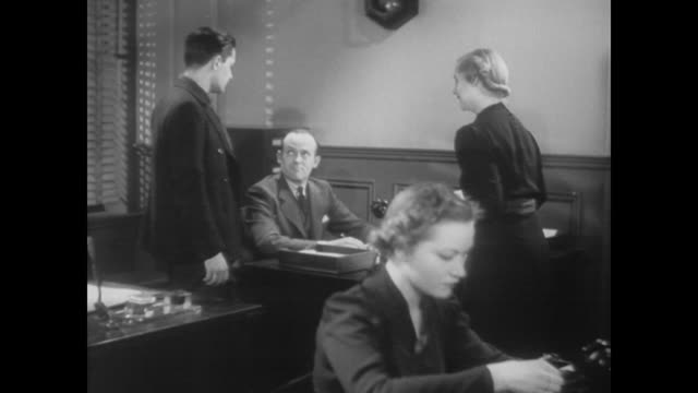 1938 laid off worker meets with unemployment officer and receive new job lead immediately - vacancyサイン点の映像素材/bロール