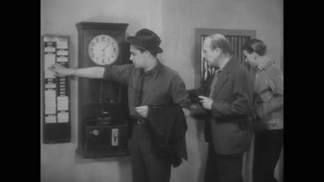 stockvideo's en b-roll-footage met 1938 laid off workers arrive at the unemployment office and begin filling out forms - 1930
