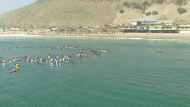 laird hamilton at the a day at the beach paddle out protest at malibu beach in malibu california on october 22 2006 - malibu beach stock videos & royalty-free footage